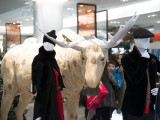 A giant wooden moose greets customers
