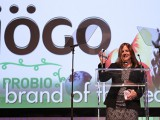 Iögo's VP of marketing Lucie Rémillard holds up her Brand of the Year trophy.