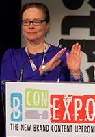 Co-chair Judy Davey, EVP activation, ZenithOptimedia, addresses the audience