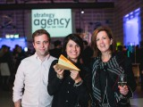 OMD staffers show off their Gold Media AOY trophy