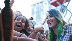 Jenna Marbles greets fans on the YouTube FanFest red carpet