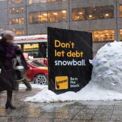 """Interac capitalized on the first snowfall of the season with a series of ambient executions that used Mother Nature to stop Canadians in their tracks with a giant snowball. Another execution featured a melting snowman with the line """"Don't get burned by credit fees""""."""