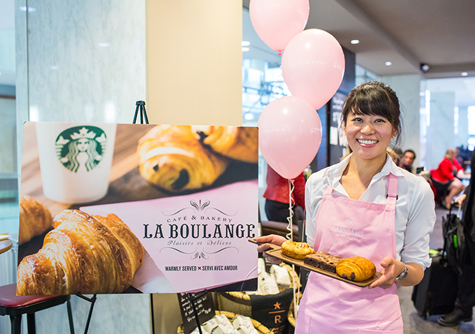 A Starbucks barista shares a selection of French-inspired pastries from La Boulange as part of the coffee shop's partnership with  the bakery.