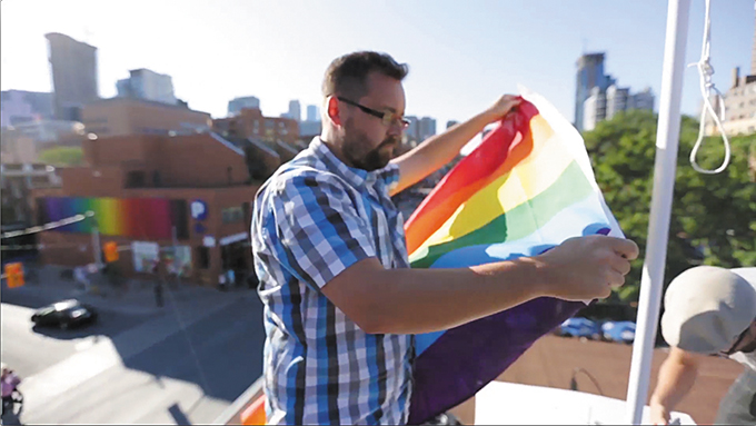 Positive and negative tweets controlled a rainbow flag for PFLAG's