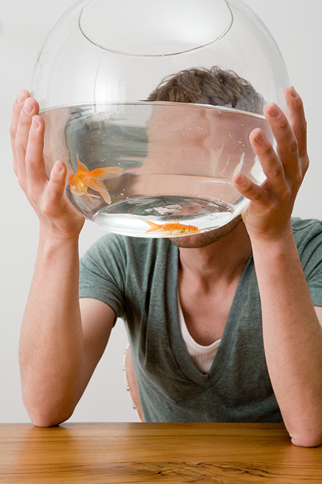 Man holding a goldfish bowl