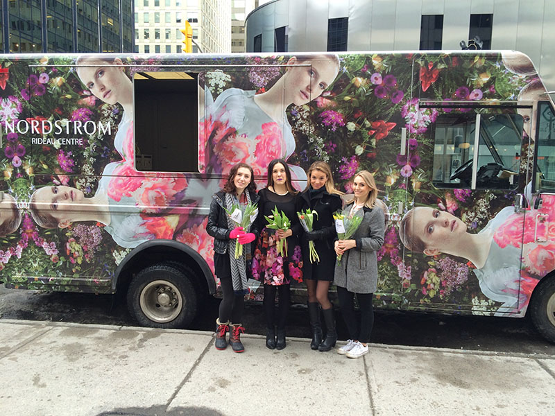 Nordstrom welcomed spring with a floral-wrapped truck and brand ambassadors handing out tulips to shoppers.