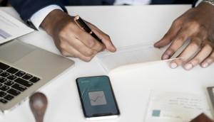 Businessman checking bankbook