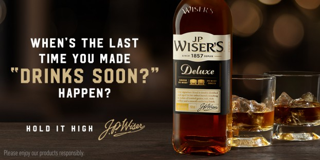 "J.P. Wiser's encouraged people to follow through on the promise of getting together socially with the headline ""Drink Soon?"" This is the third year in the continuing ""Hold It High"" campaign."