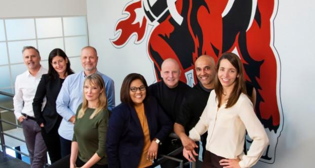 The doug&partners senior team, from left: Doug Robinson, Kristin Burnham, Matt Syberg-Olsen, Moxie Garrett, Bonnie Lall, Adam White, Brad Kumar and Caroline Kilgour.