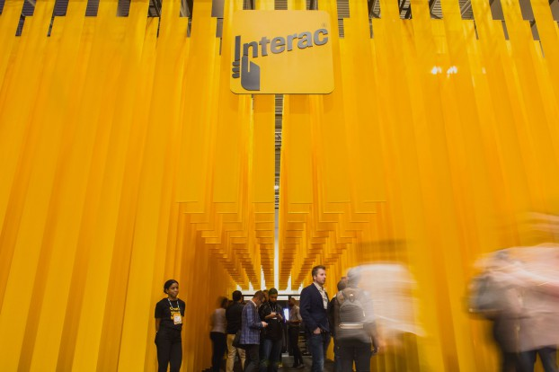 Zulu reimagined the typical tradeshow booth for Interac. Six hundred bands of flowing fabric became an architectural representation of the huge volume of financial data that Interac's systems manage every day.