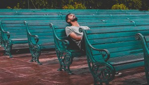 man-sitting-and-closing-eyes-on-teal-bench-1076999