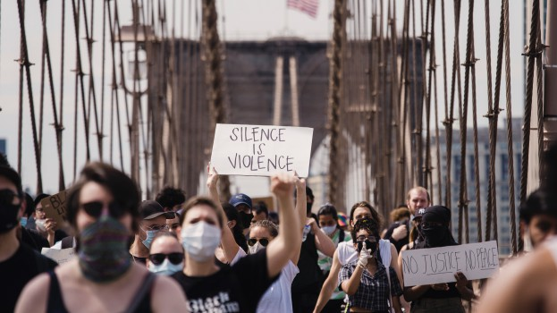 crowd-of-protesters-holding-signs-4614166
