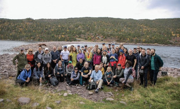 The company that plays together stays together. Seen here are Bruce MacLellan (centre front) and his team enjoying the great Canadian outdoors together.