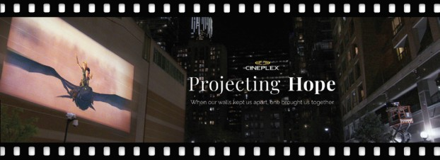"""With the world stuck at home, Zulu worked with Cineplex on """"Projecting Hope"""" to recapture the joy of going to the movies – with How to Train Your Dragon screening outdoors on the 40-foot wall of the YMCA in downtown Toronto."""