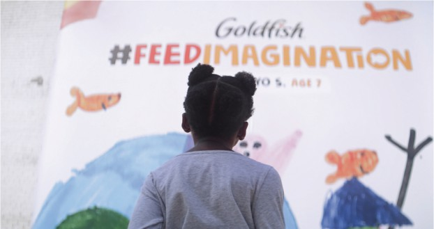 For Goldfish, the imaginations of three children were brought to life – as an illustrated book, an interactive video game, and a painting transformed into a large city mural.